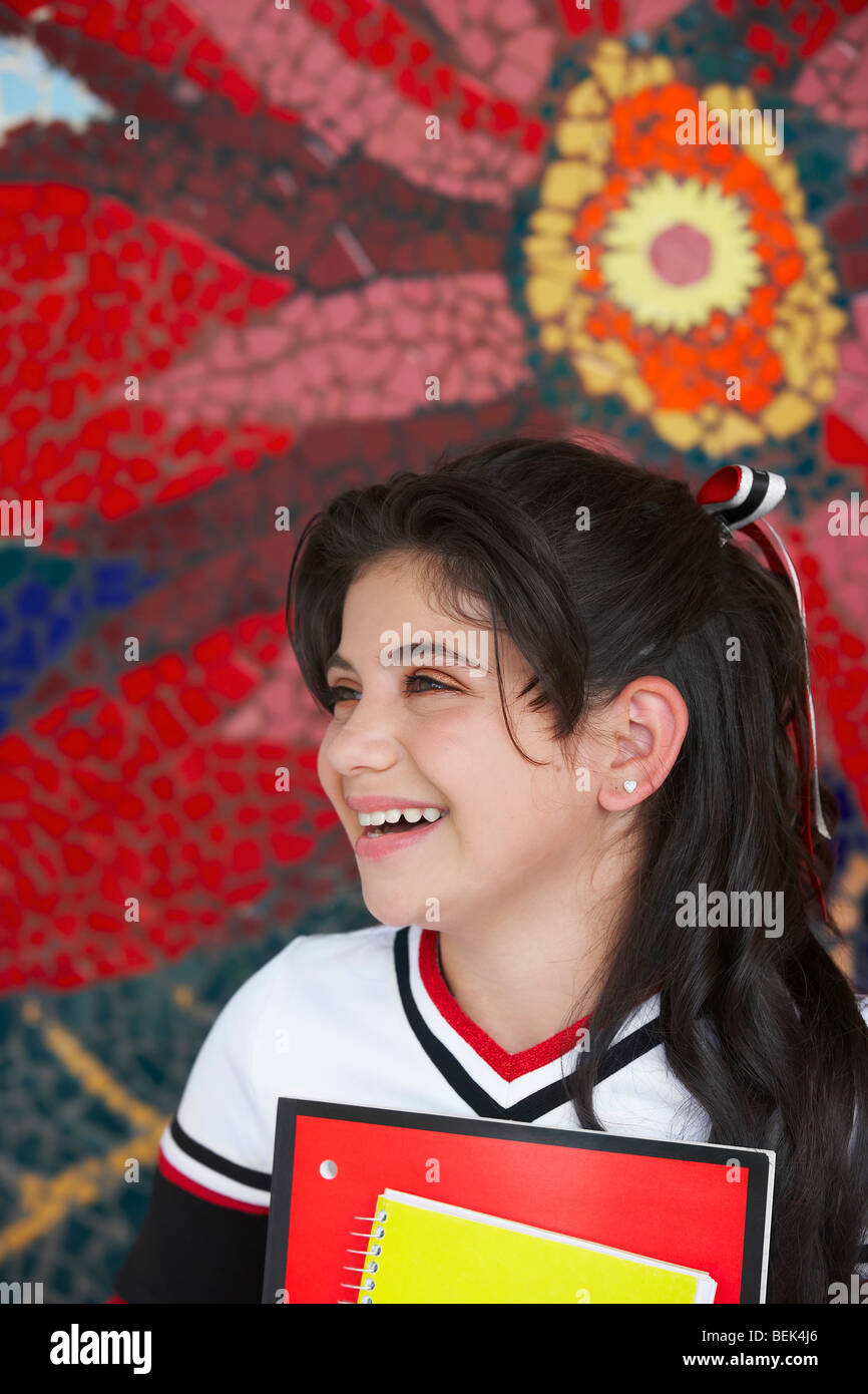 Close-up of a cheerleader smiling - Stock Image