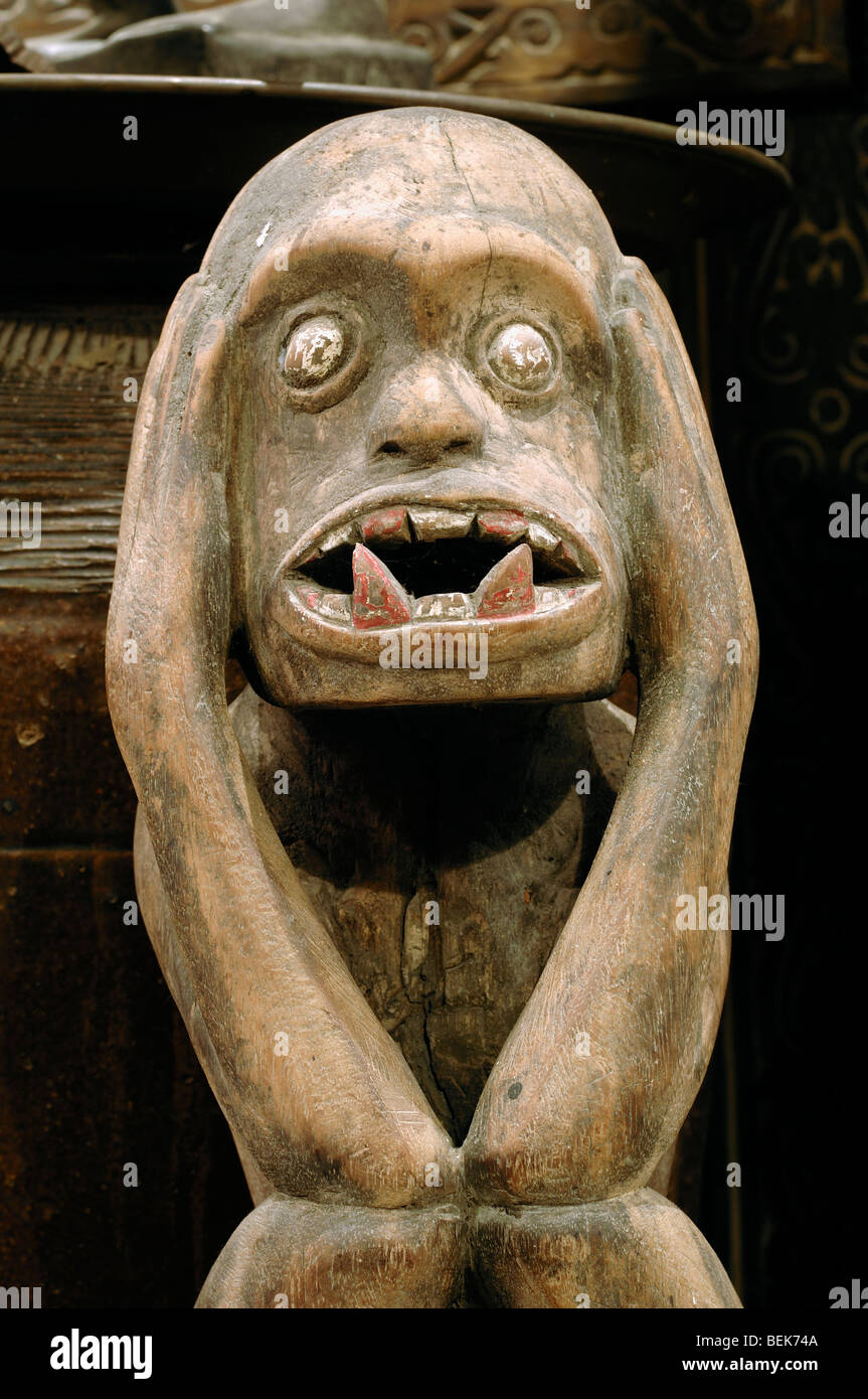 Tribal Carving or Primitive Figurative Art of a Wooden Carved Forest Spirit from Sarawak Malaysia Borneo - Stock Image