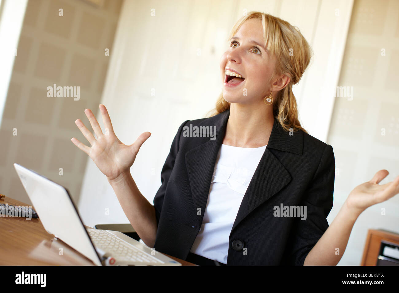 Happy woman in office Stock Photo