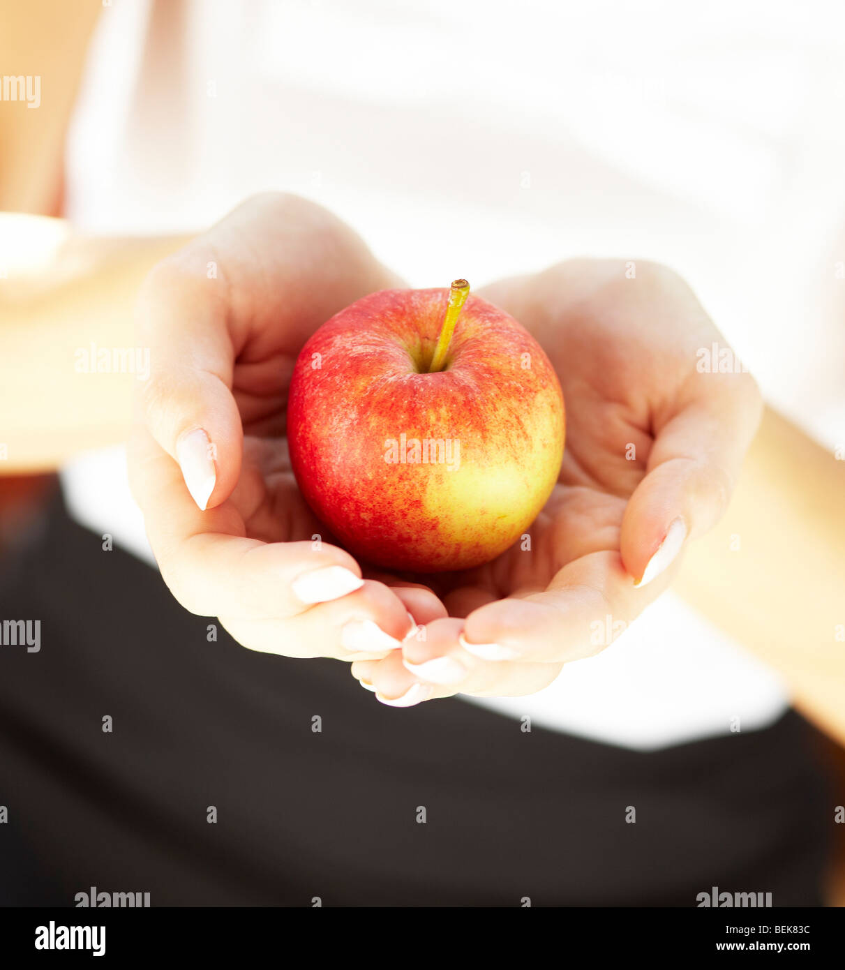Close up of person holding apple - Stock Image