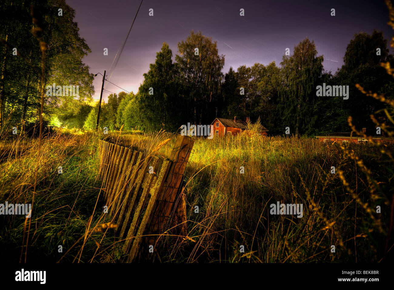 Old cabin landscape with star trails - Stock Image