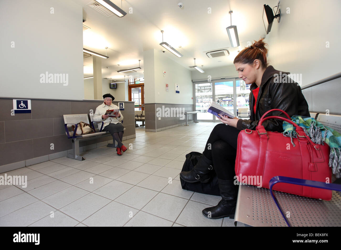 Passengers in Scotrail waiting room at Aberdeen railway station, Scotland, UK - Stock Image