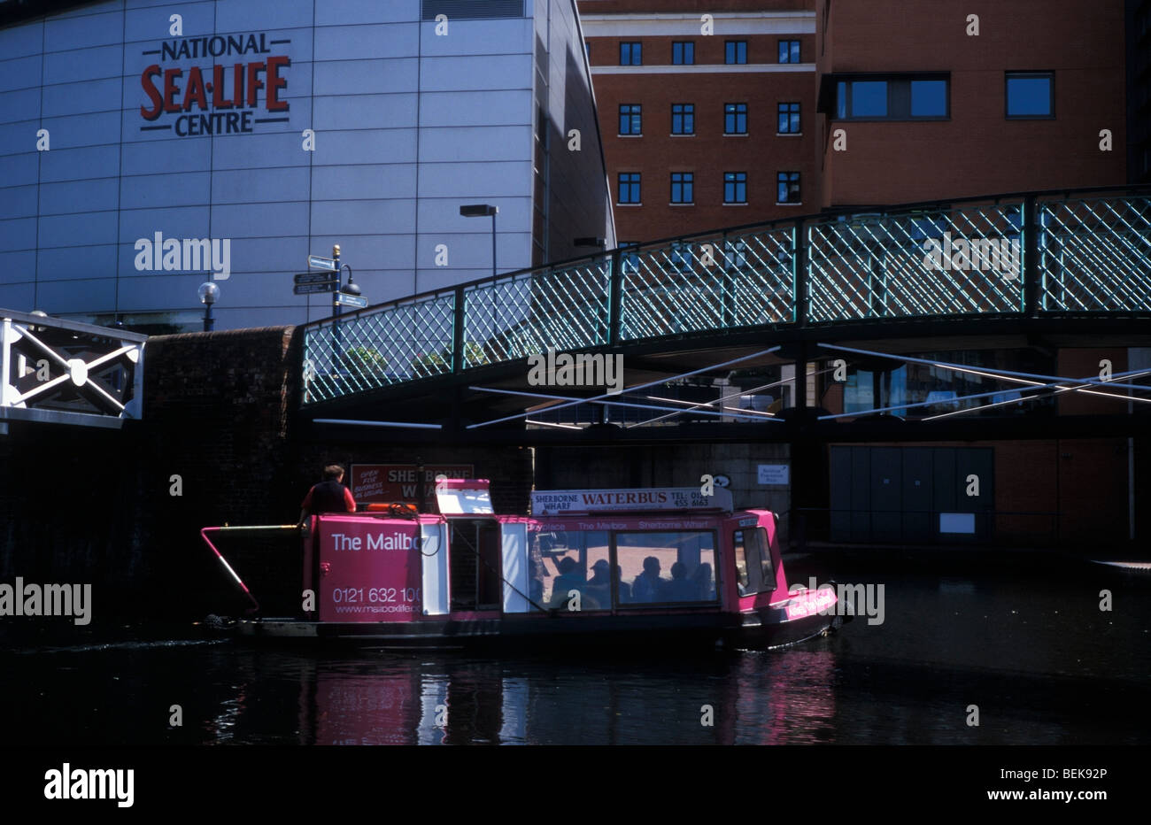 Waterbus in front of the National Sea Life Centre Birmingham UK - Stock Image