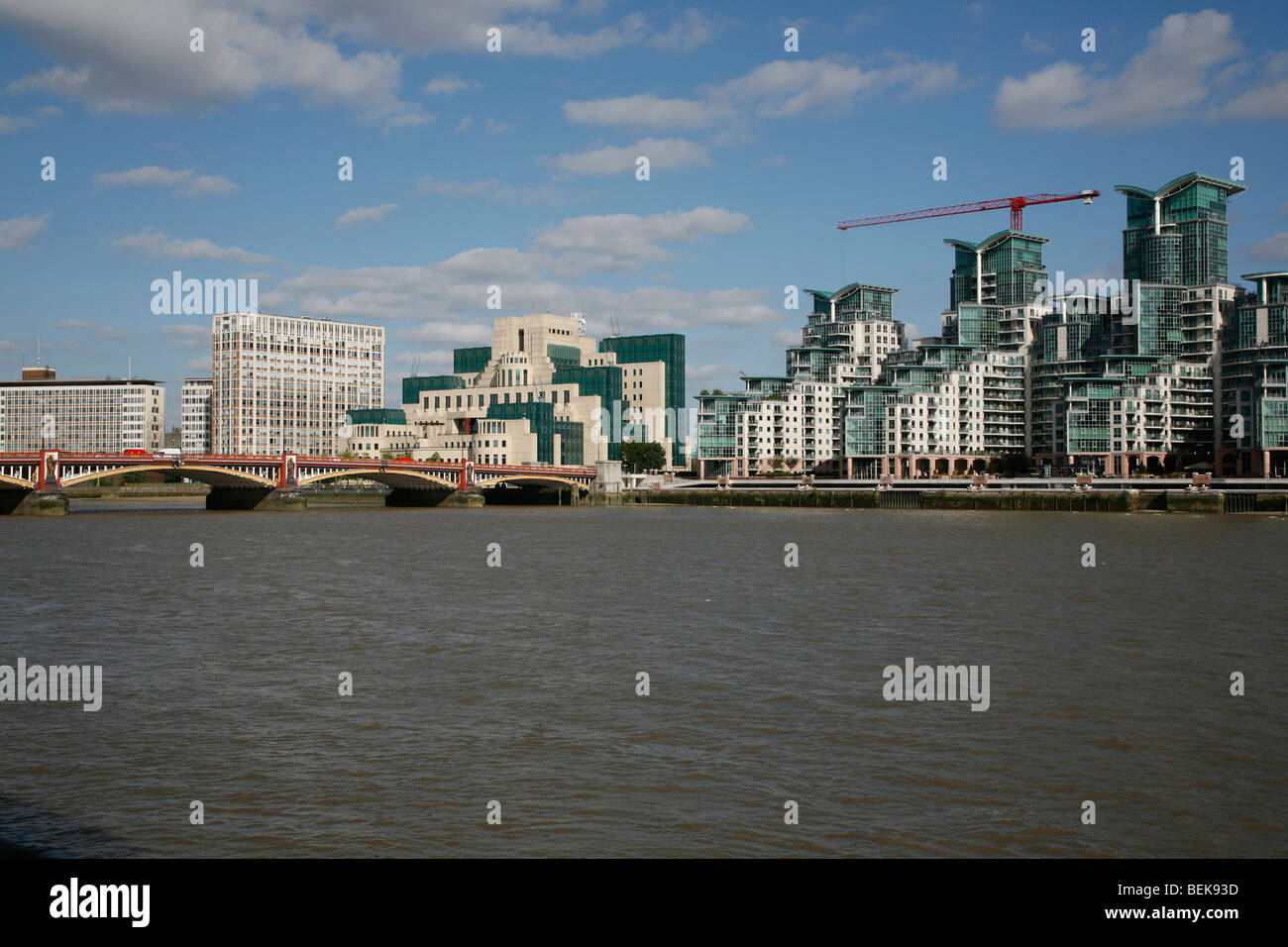 Looking across the River Thames to Vauxhall Bridge, MI6 Building and St George's Wharf, Vauxhall, London, UK - Stock Image