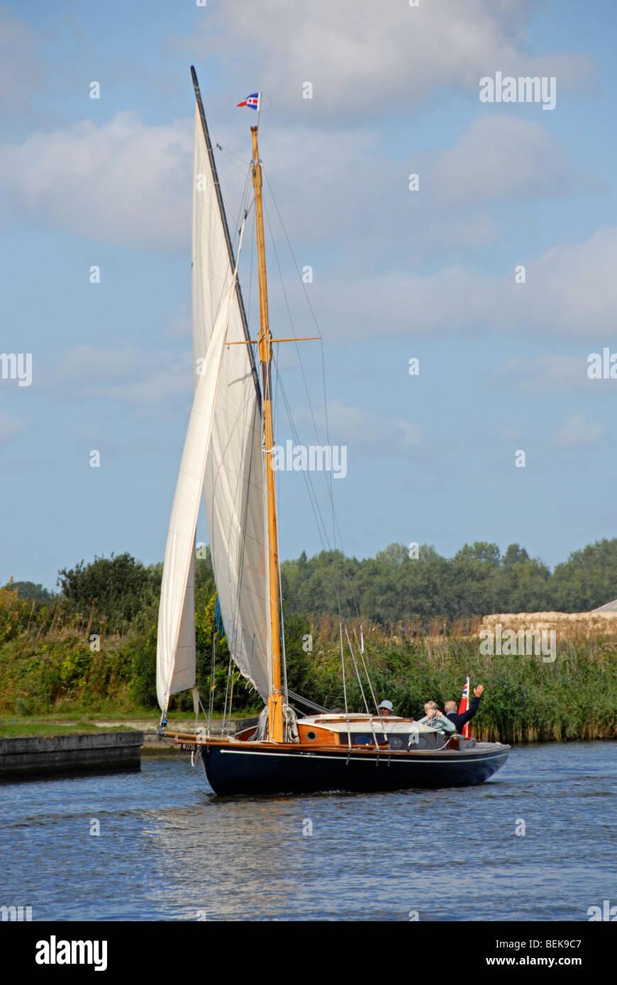 Sailing boat on River Thurne, Norfolk Broads - Stock Image