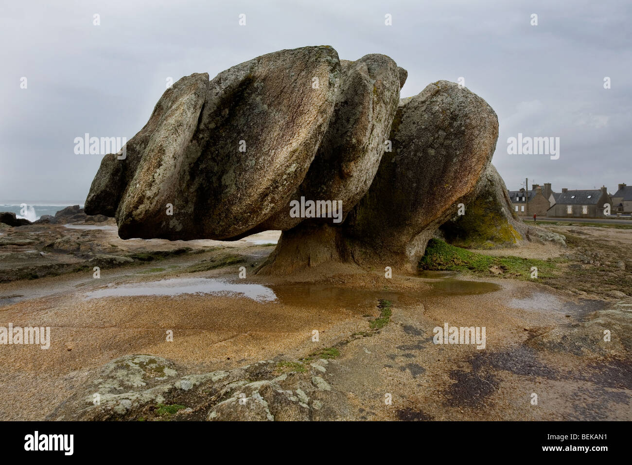 Eroded rock formation by wind erosion at the coast in Saint-Guénolé, Finistère, Brittany, France - Stock Image