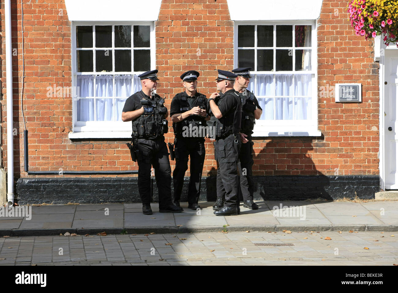 SWAT Police on duty wearing full body armor and carrying guns in Wootton Bassett Wiltshire - Stock Image