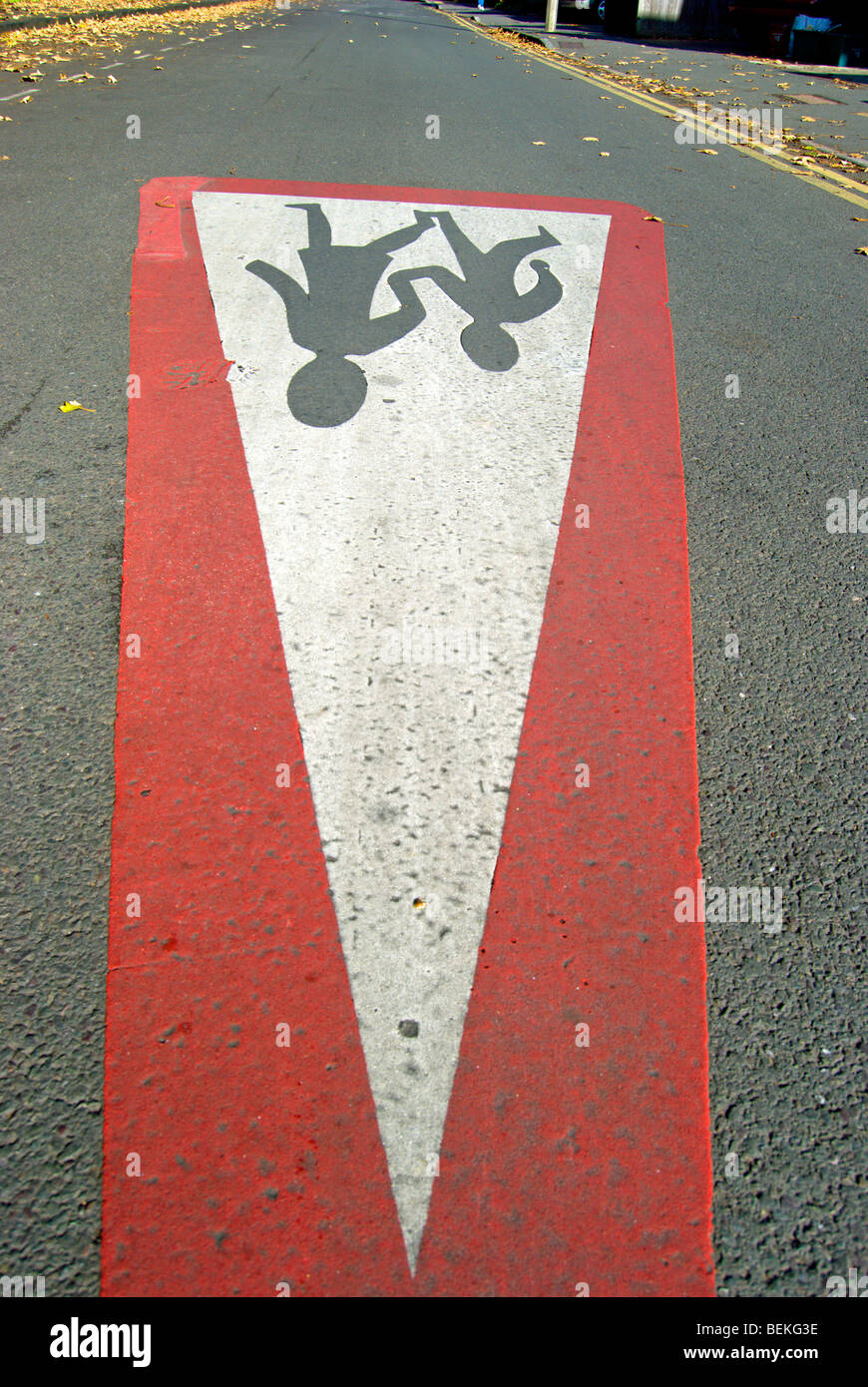 seen from an unusual angle, a british road marking indicating a place where children are likely to be crossing the - Stock Image