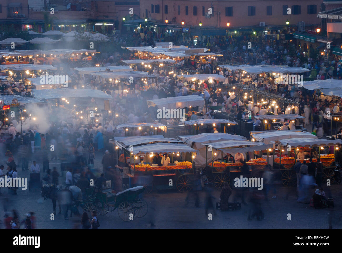 Busy food stalls of Djemaa el Fna, Marrakesh, Morocco at dawn. - Stock Image