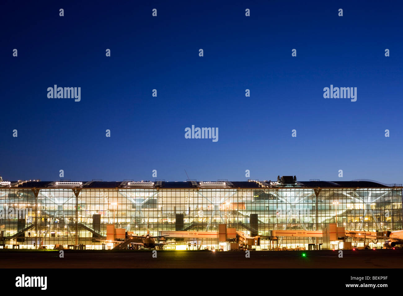 An wide exterior early evening view of Heathrow Airport's Terminal 5 building in West London. - Stock Image