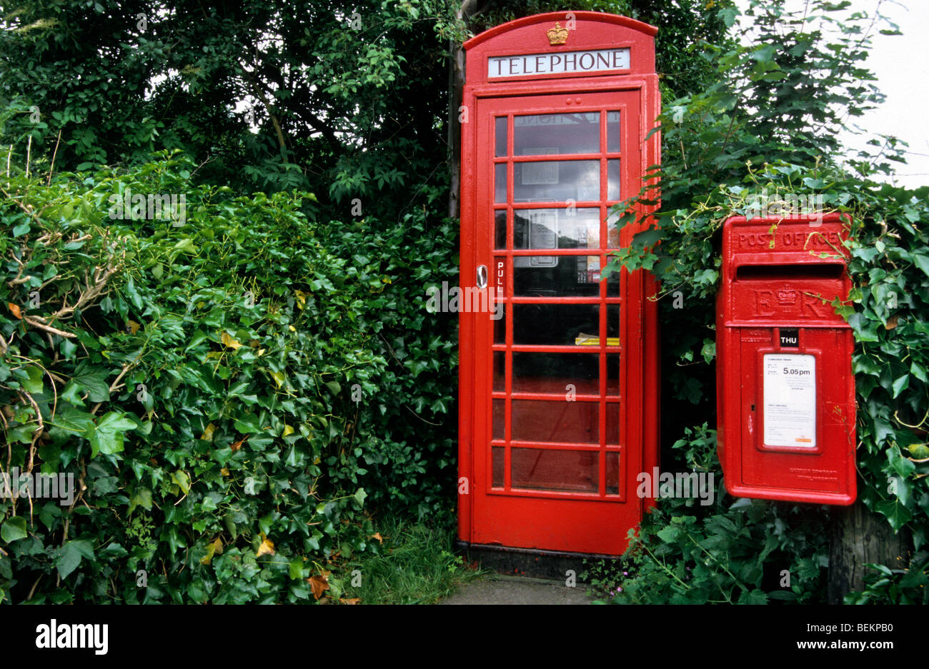 Classic red phone booth and postoffice box at Yorkshire, England, UK - Stock Image