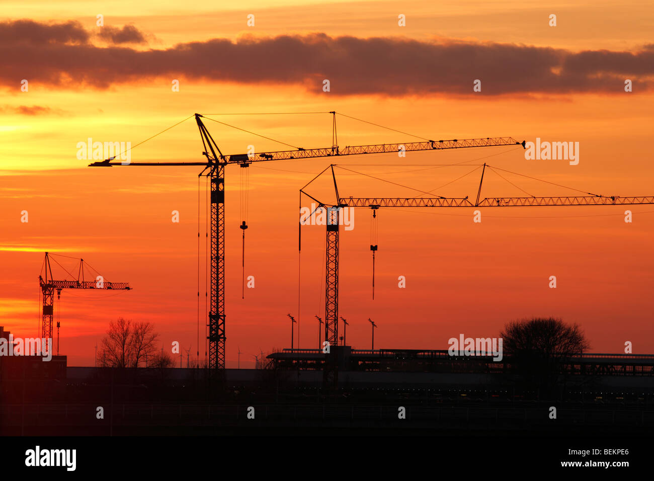 tower cranes at the airport Leipzig-Halle, Germany Stock Photo