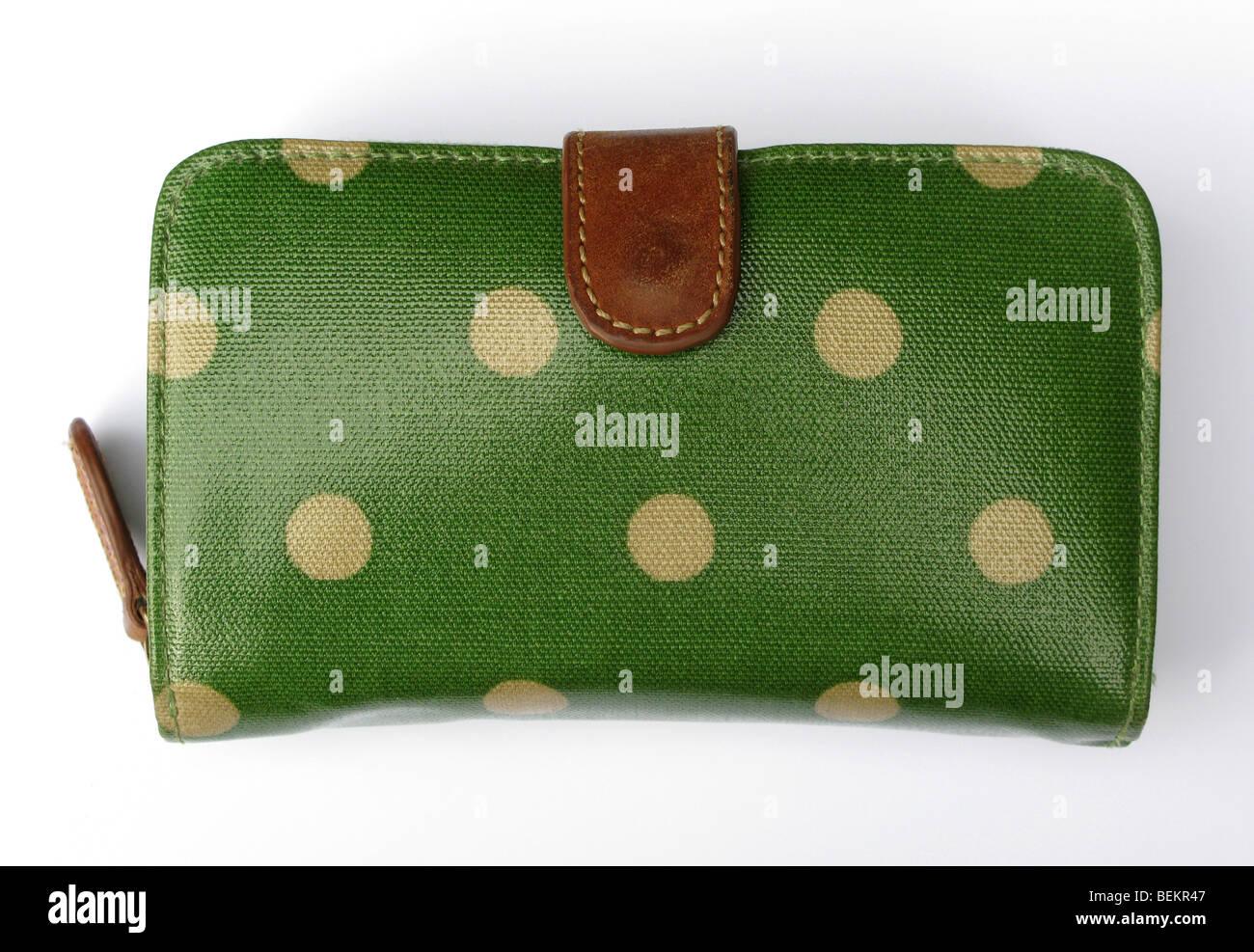 Green Cath Kidston purse on white background - Stock Image