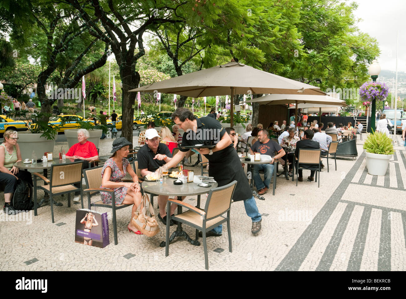 People relaxing in street cafes, Funchal, Madeira - Stock Image