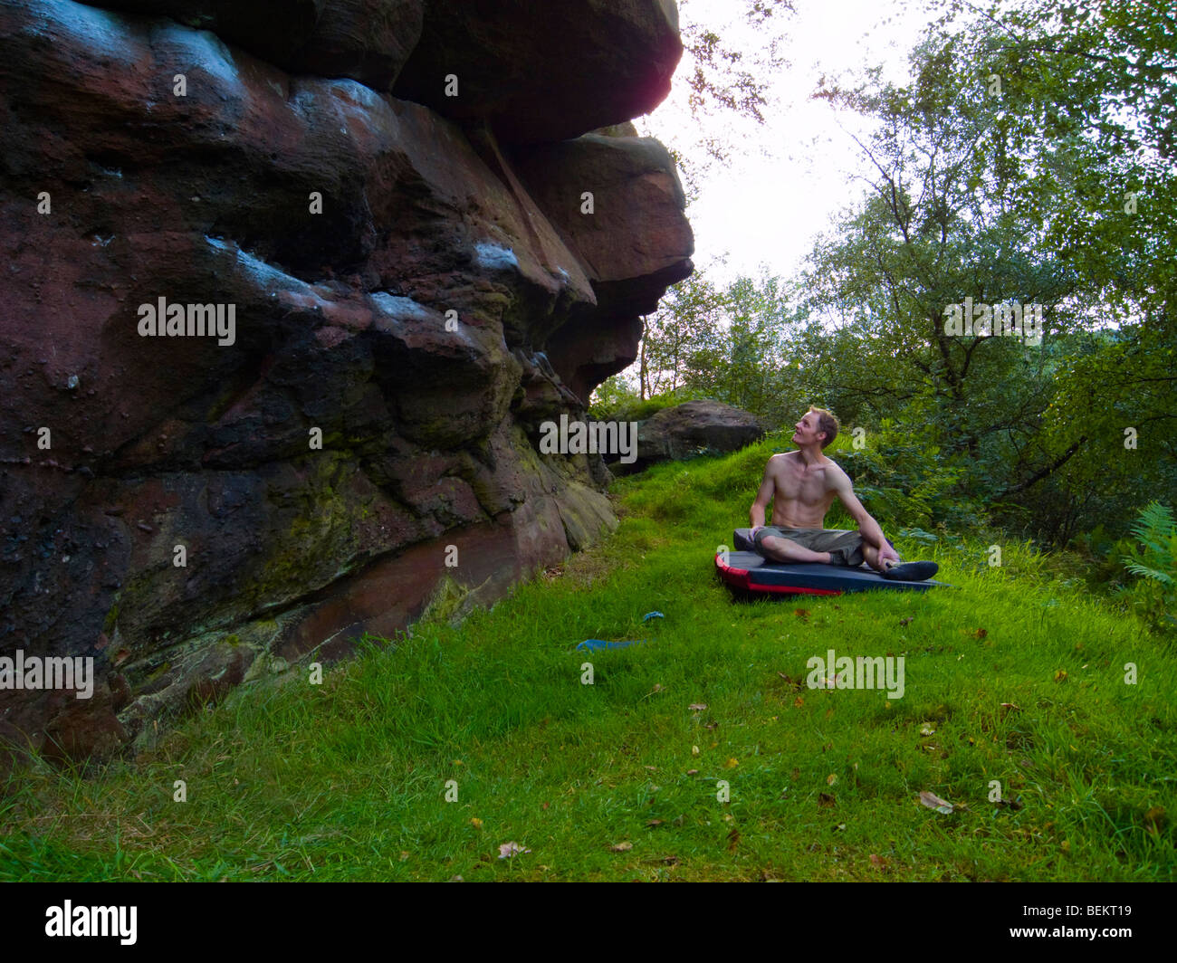 Climber about to do a boulder problem in the Churnet Valley Staffordshire - Stock Image