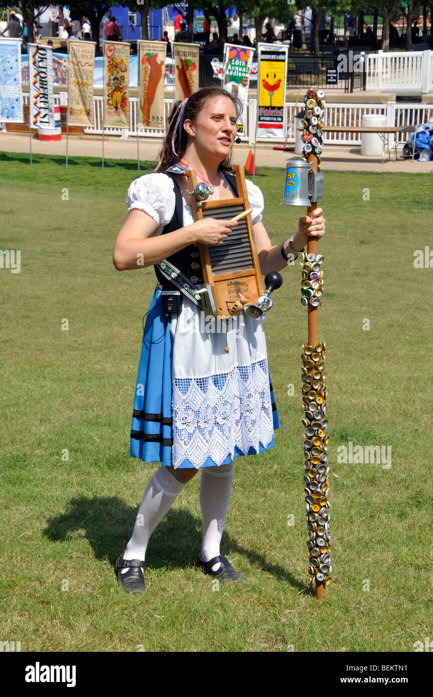 Female singer in German traditional costume at Oktoberfest in Addison, Texas, USA - Stock Image