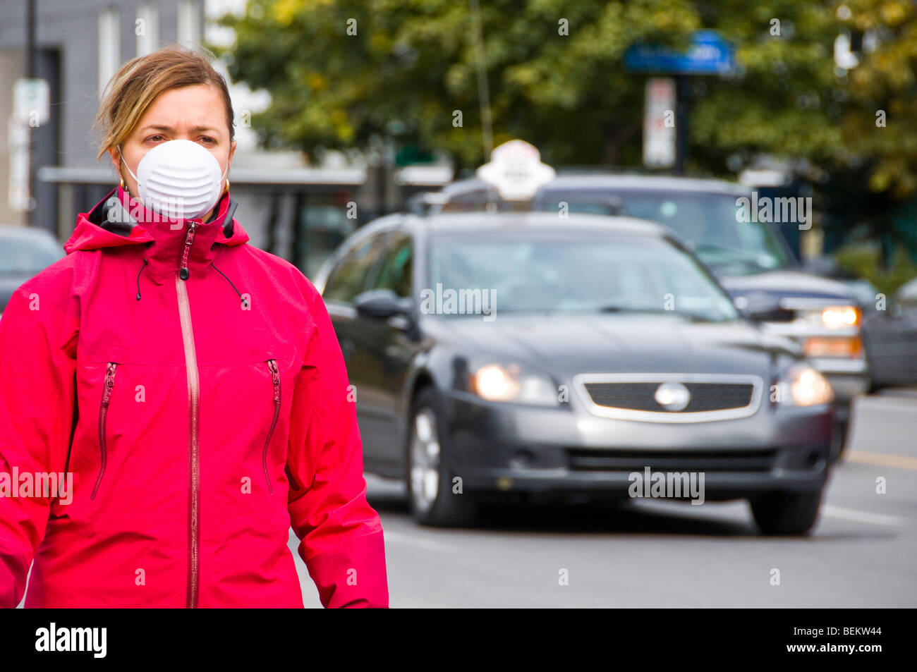 Woman wearing a protective mask  street traffic - Stock Image