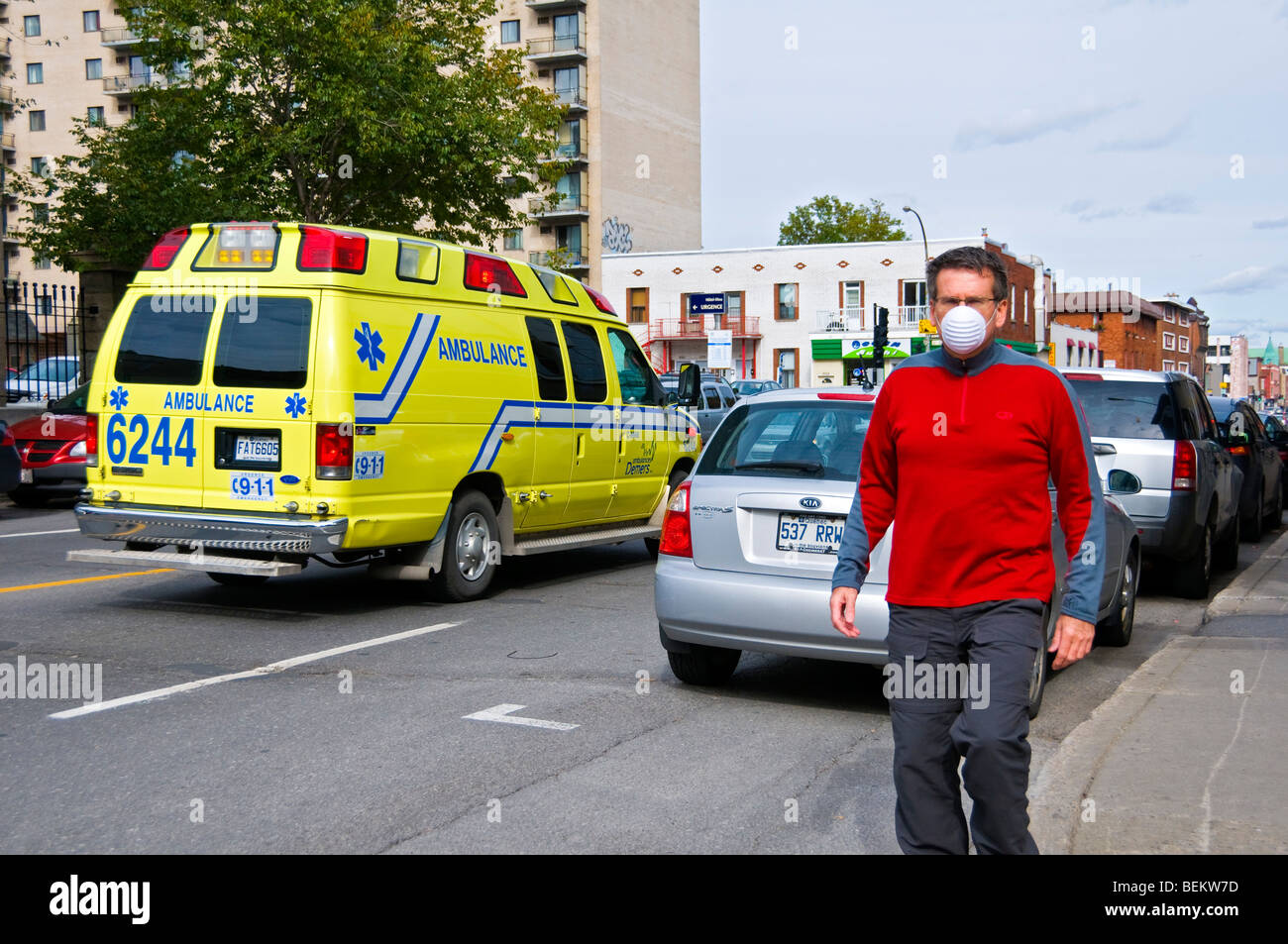 Man walking with protective mask - Stock Image