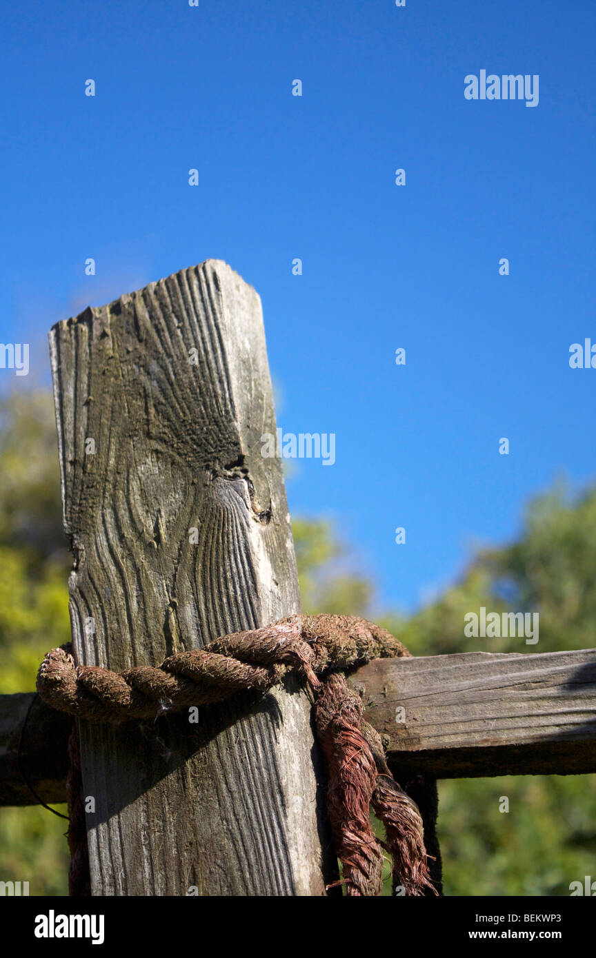 Tied up fence - Stock Image