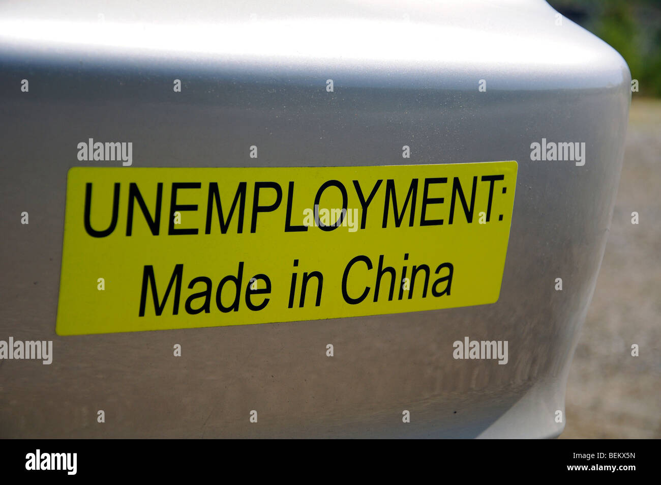 Bumper sticker: 'Unemployment: Made in China' - Stock Image