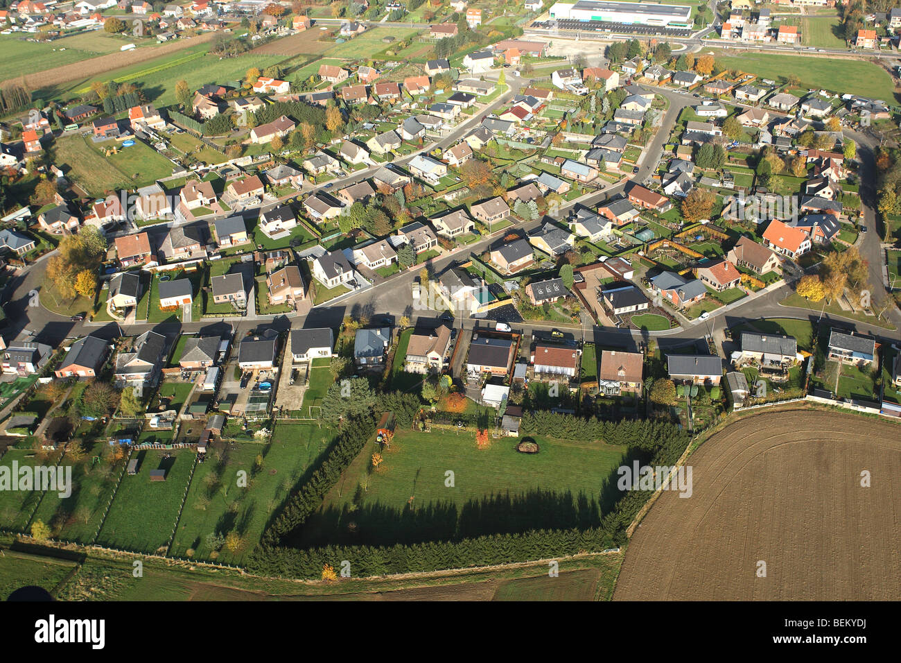 Urbanisation at the border of agricultural area from the air, Belgium Stock Photo