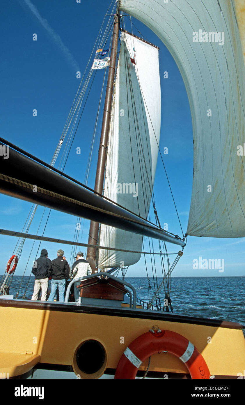 Yachtsmen on clipper along the Frisian islands, the Netherlands - Stock Image