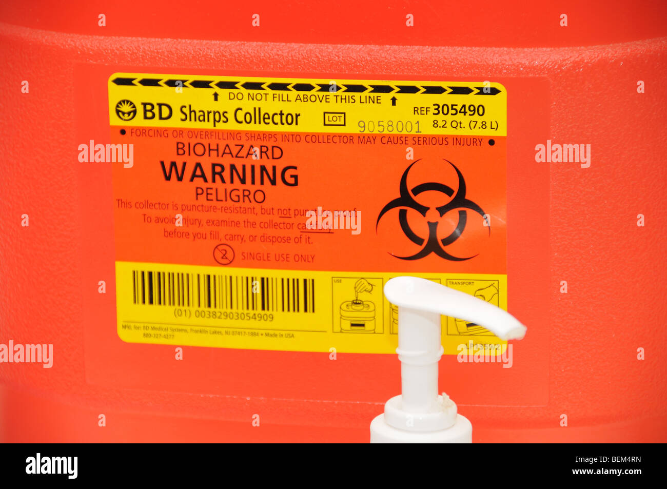 A bio hazard warning label on a syringe collection container for the 2009 H1N1 influenza shot, also known as the - Stock Image