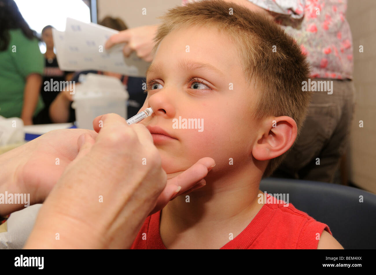 A 4-year-old boy is vaccinated for the 2009 H1N1 influenza, also known as the Swine Flu, with an intranasal vaccine. - Stock Image