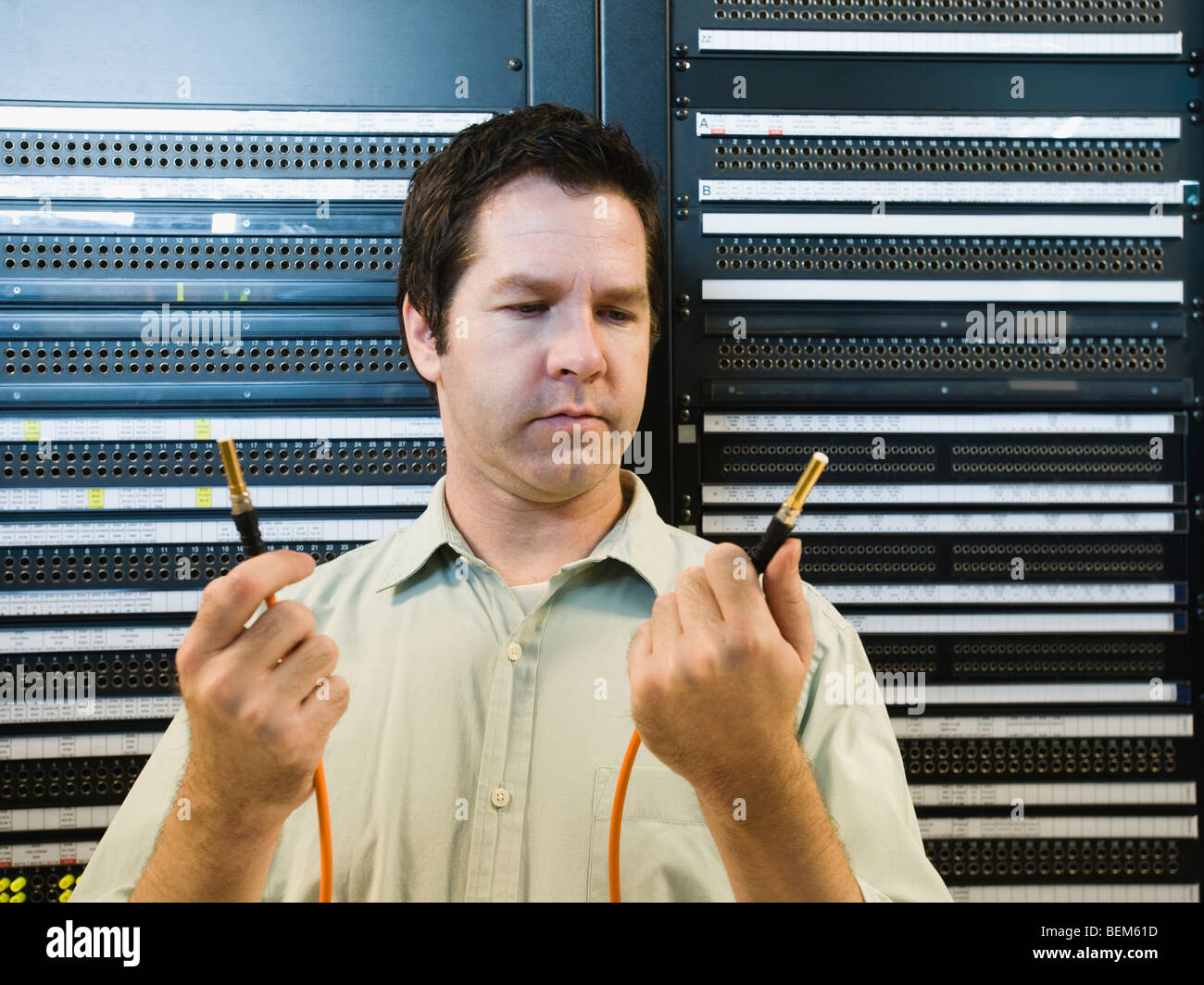 Man working in data center - Stock Image