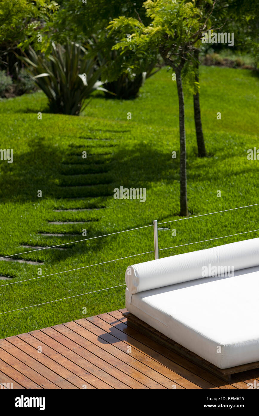 Sunbathing bed on deck at resort - Stock Image