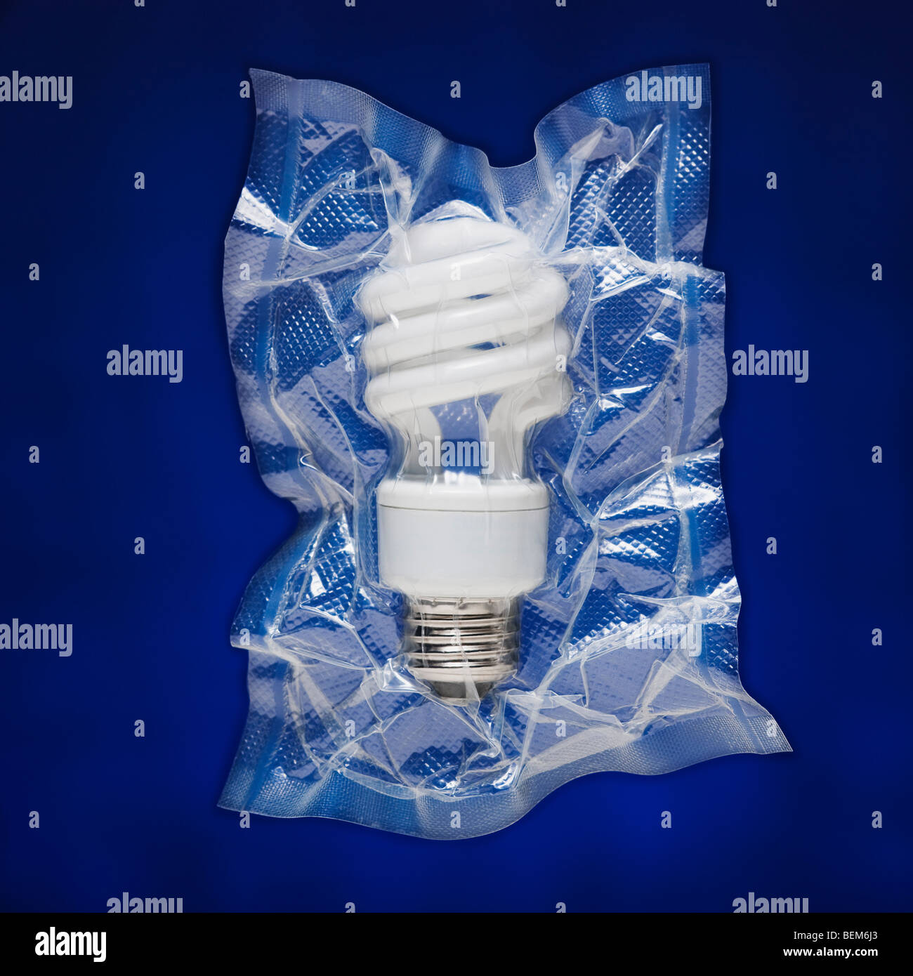 Shrink wrapped light bulb - Stock Image