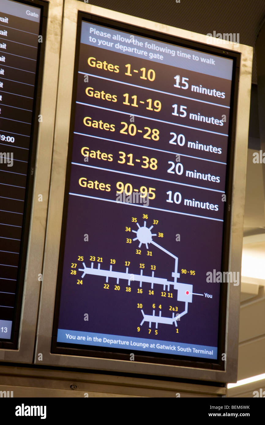 Display screen showing distance time to the departure gates in the departure lounge of Gatwick airport. London. Stock Photo