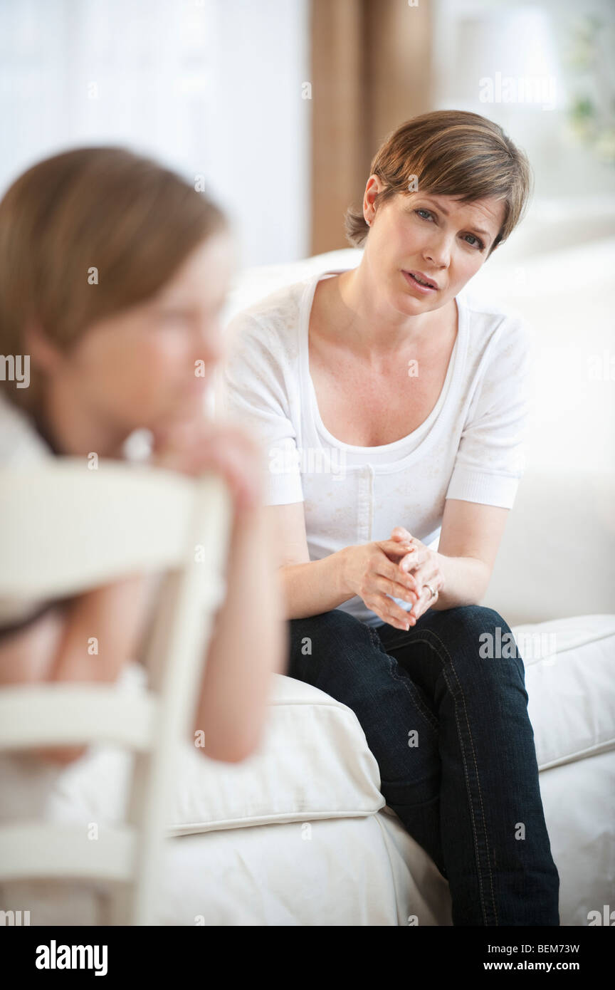 Mother talking with child - Stock Image