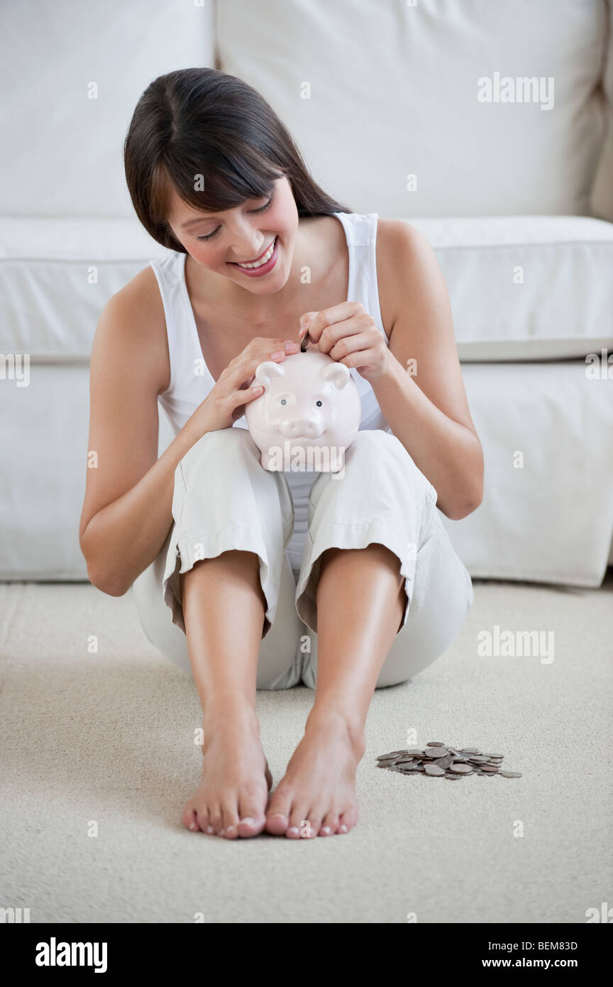 Woman with piggy bank - Stock Image