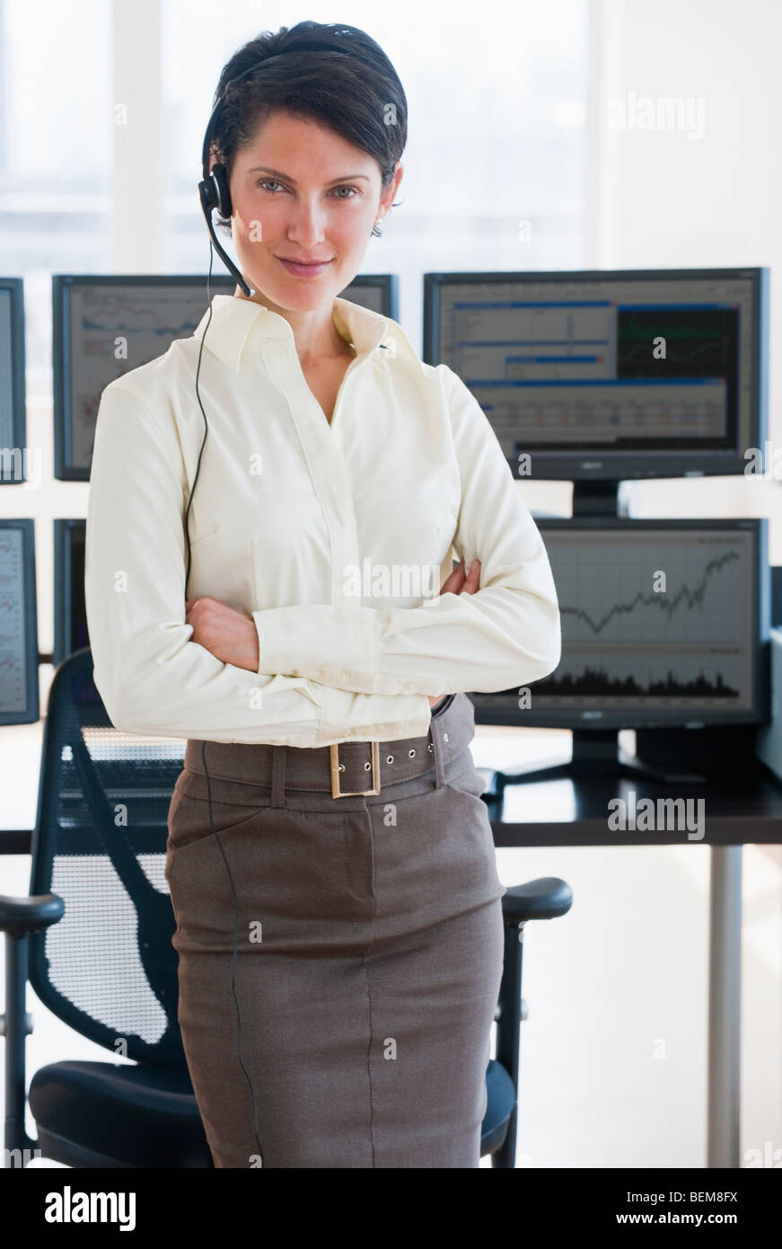 Female trader looking at camera Stock Photo