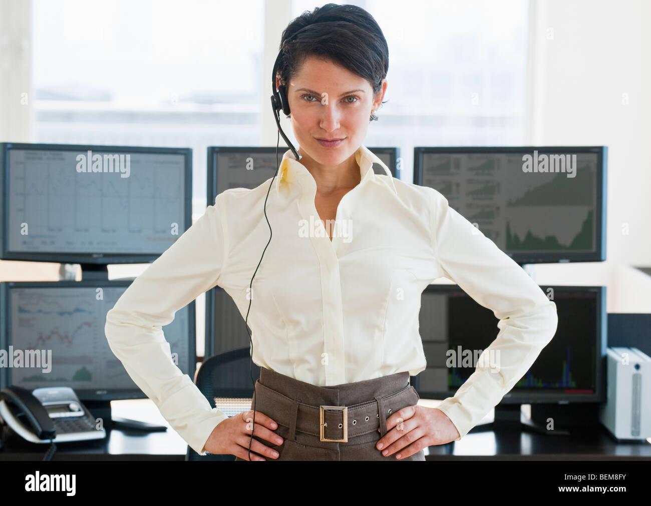 Female trader looking at camera Stock Photo