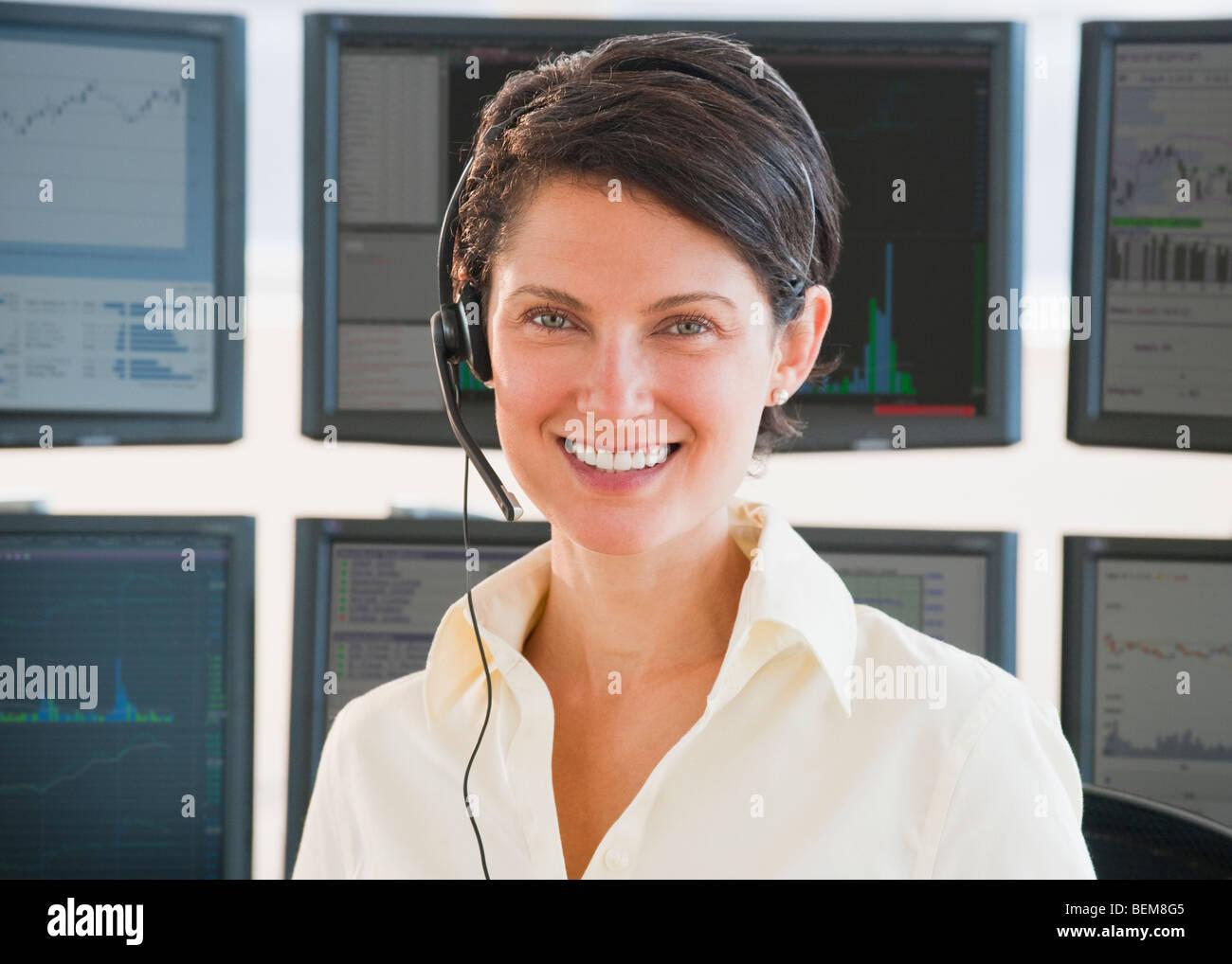 Female trader on headset Stock Photo