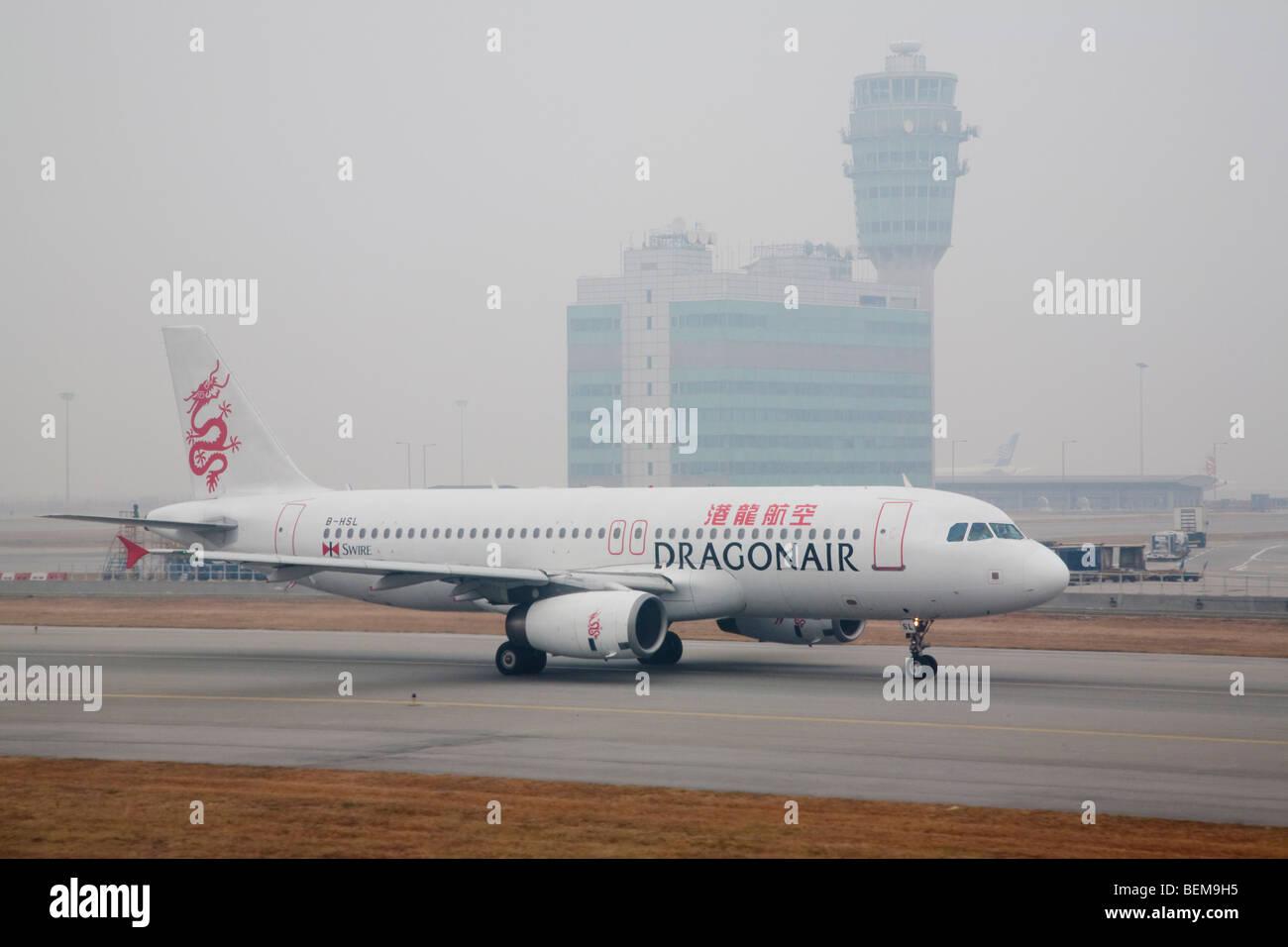 A DragonAir Airbus A320 airplane at runway. DragonAir is Hong Kong's domestic airline. Hong Kong, People's Republic Stock Photo