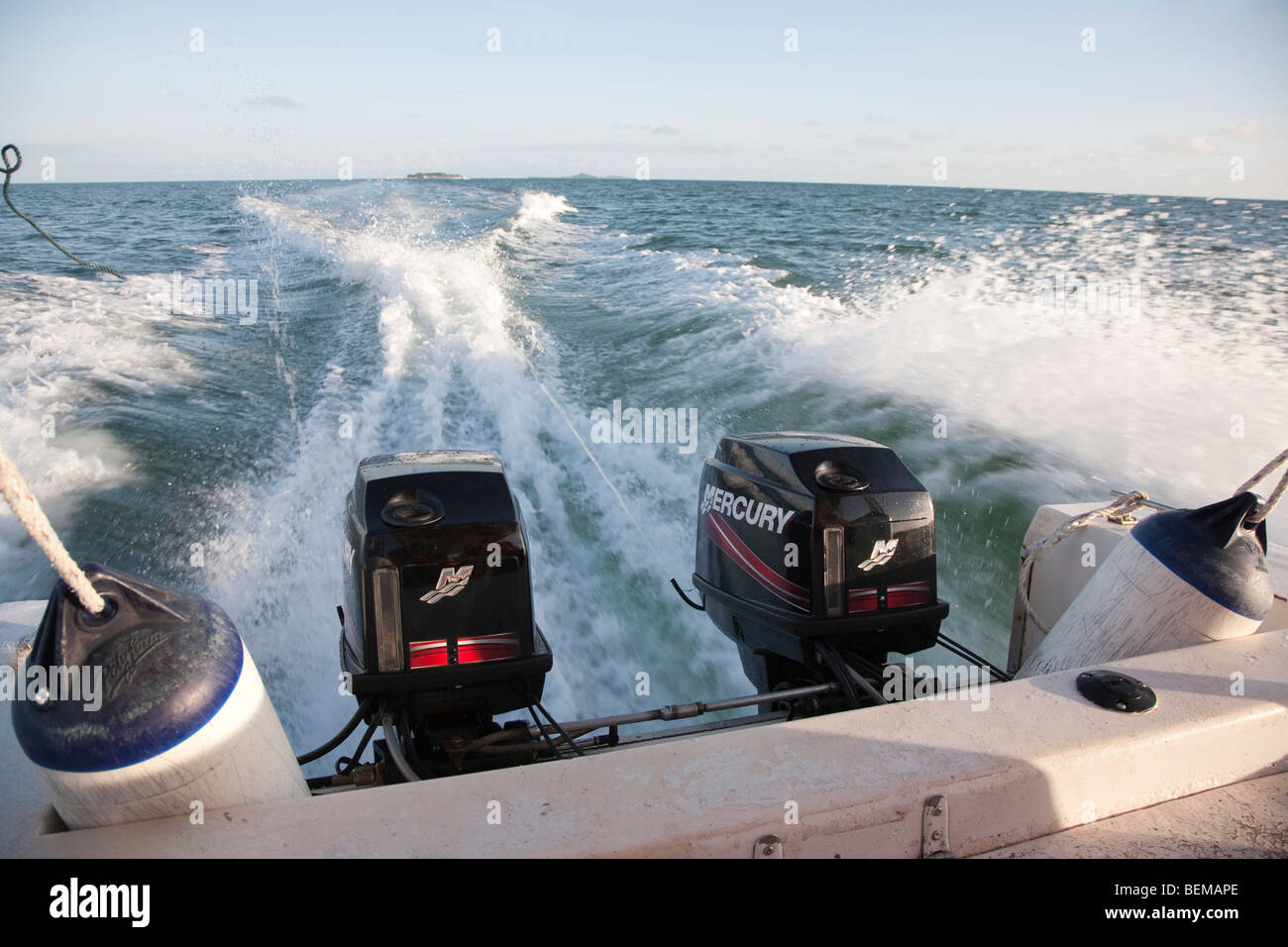 Boat with two outboard motors traveling at speed in Malaysia. - Stock Image