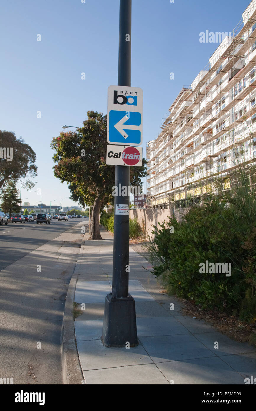 BART and Caltrain road signs near a transit oriented condo development. Millbrae, California, USA - Stock Image