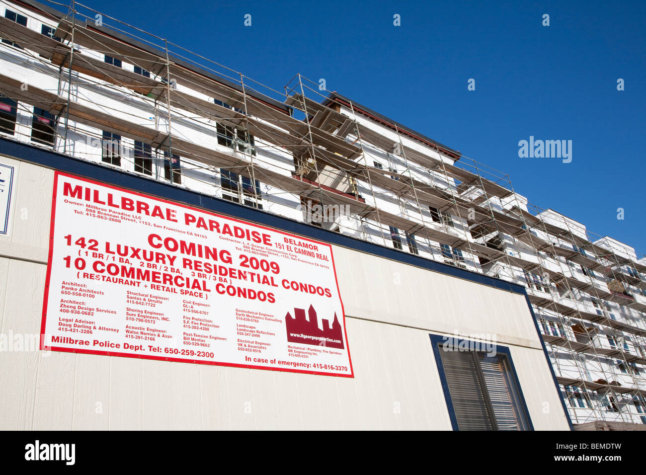 A low angle view of an advertising sign promoting a transit orientated housing development. Millbrae, California, Stock Photo