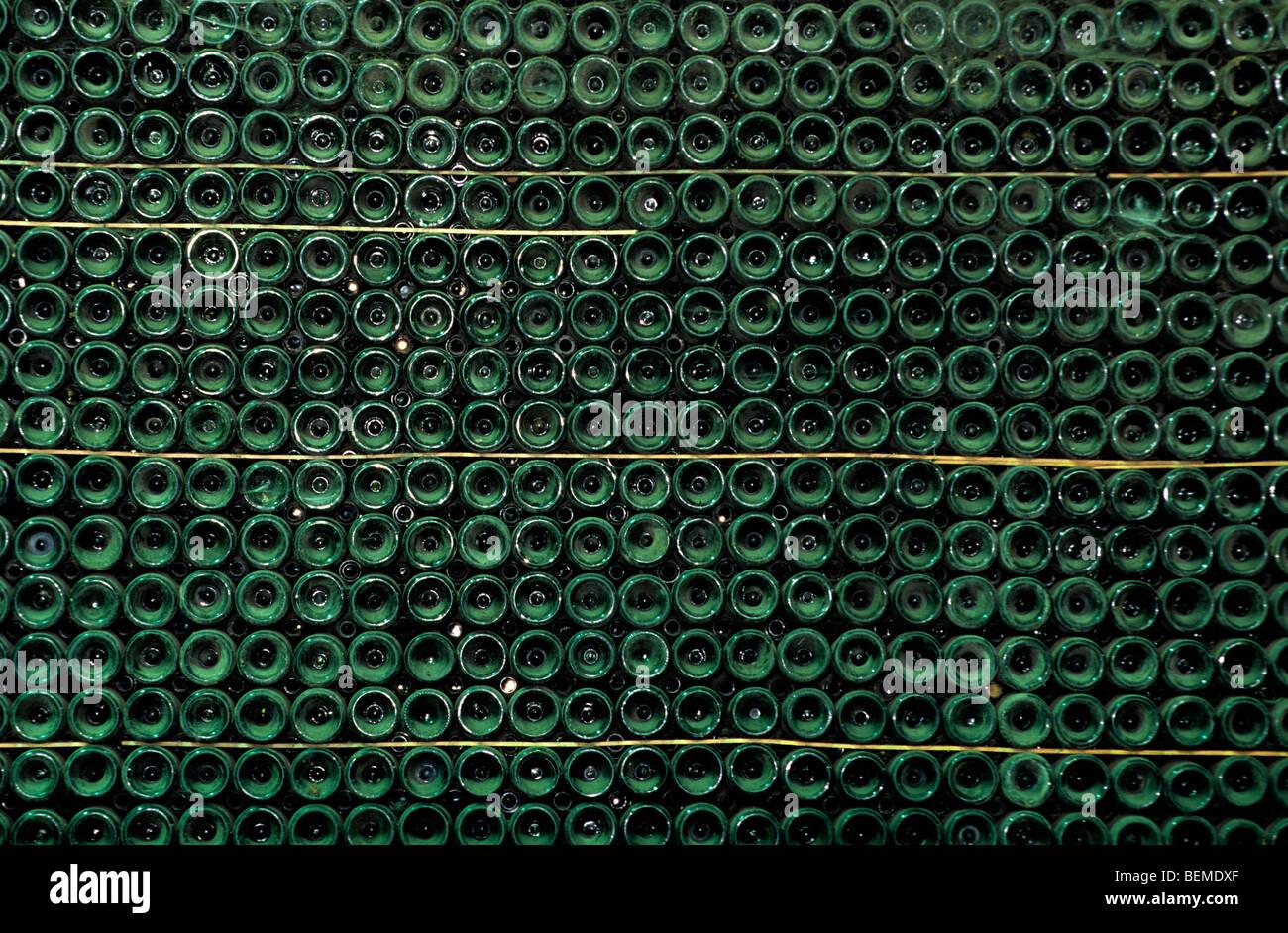 Stacked bottles of Belgian Geuze beer in brewery, Belgium - Stock Image