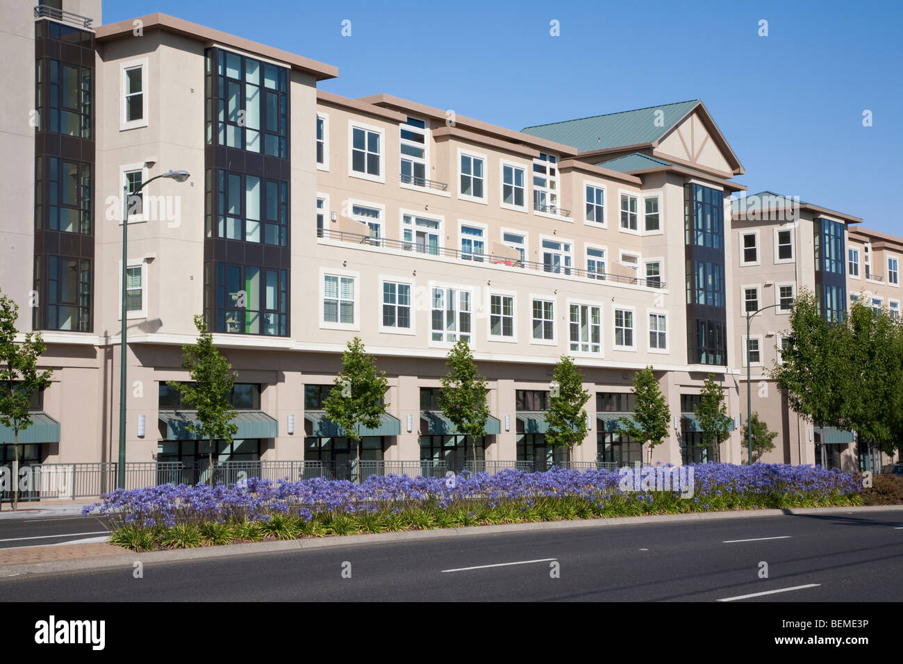 A mixed use building with apartments and office space viewed from a road. Park Broadway on El Camino Real in Millbrae, Stock Photo