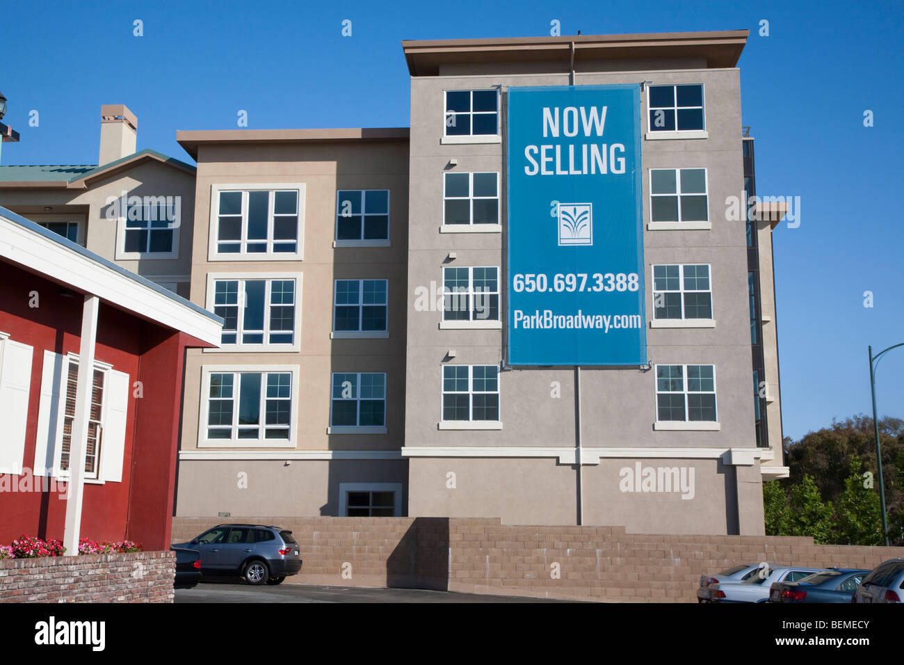 An advertising sign on a mixed used housing development. El Camino Real in Millbrae, CA, USA Stock Photo