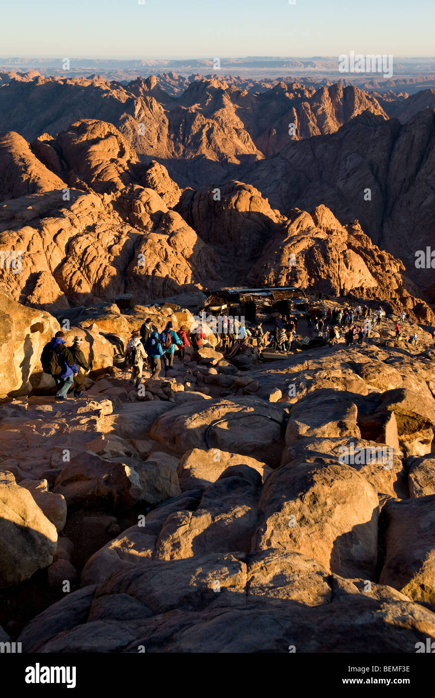 Egyptian bedouin guide and tourists early morning on trek from Mount Sinai, Egypt, Middle East - Stock Image