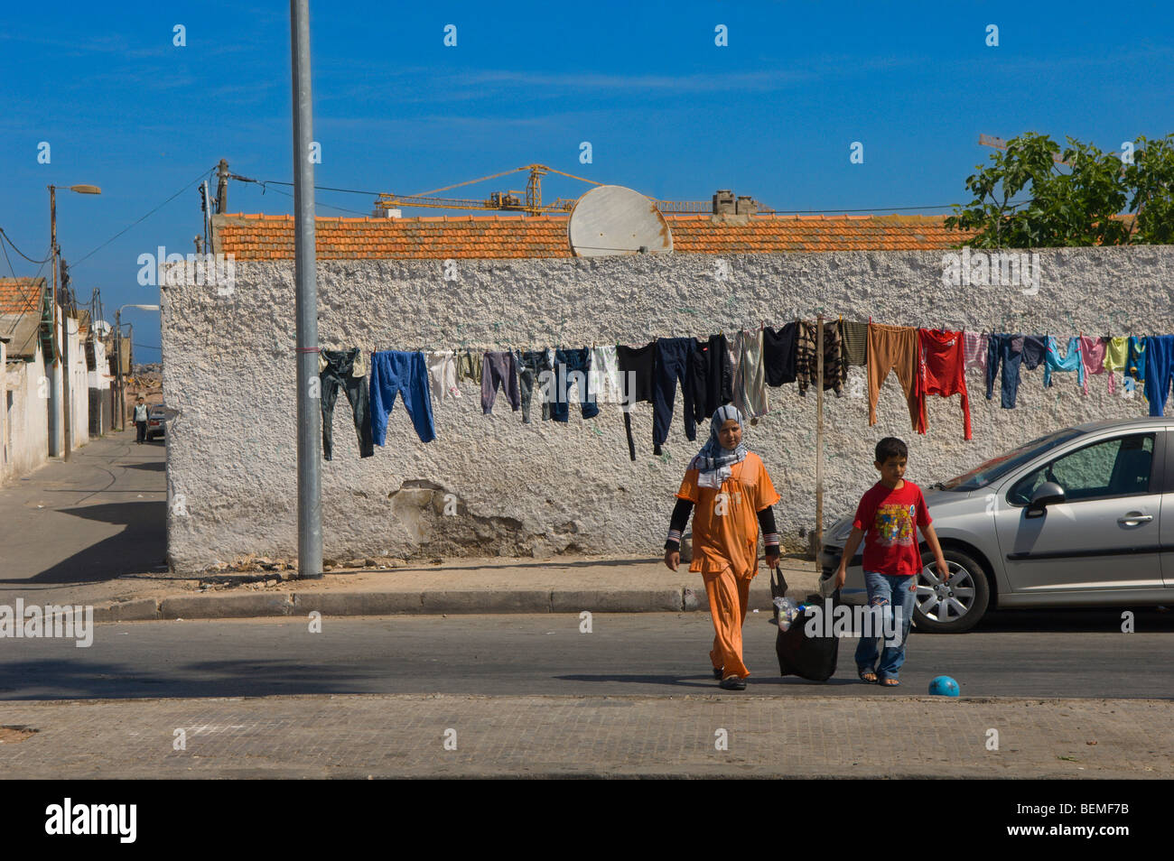 Laundry on a clothes line in a back street in Casablanca, Morocco, Africa - Stock Image
