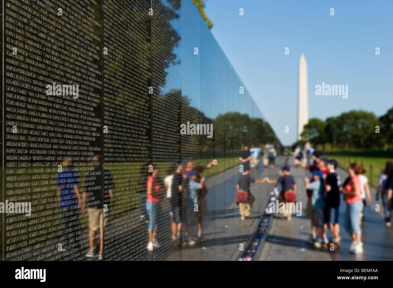 Vietnam Veterans Memorial with the Washington Monument behind, The Mall, Washington DC, USA - Stock Image