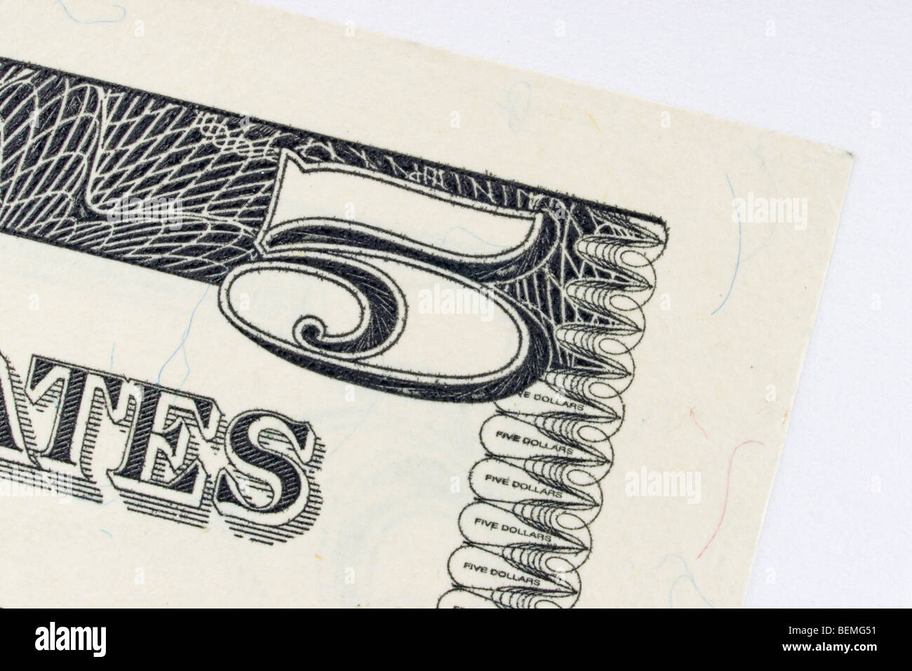 corner of United States five dollar bill - Stock Image