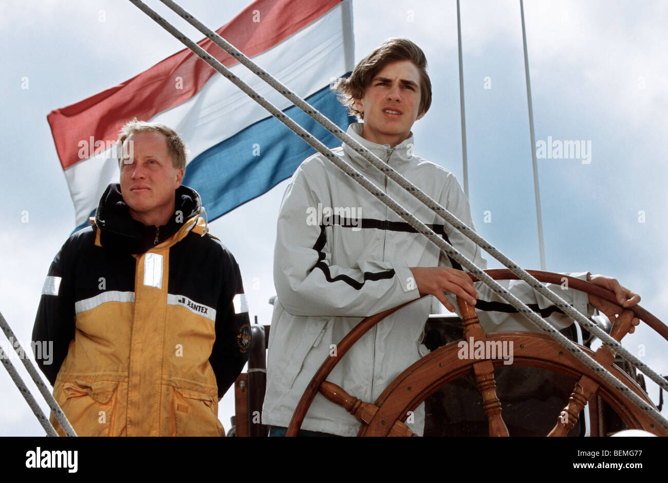 Yachtsmen on board of clipper, Wadden Sea, the Netherlands - Stock Image