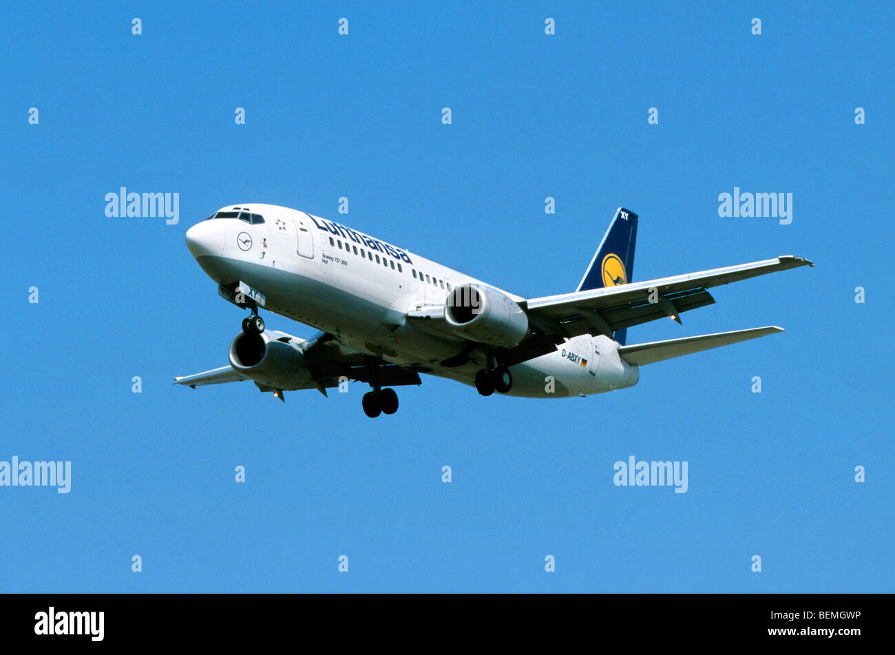 Airplane flying against blue sky - Stock Image
